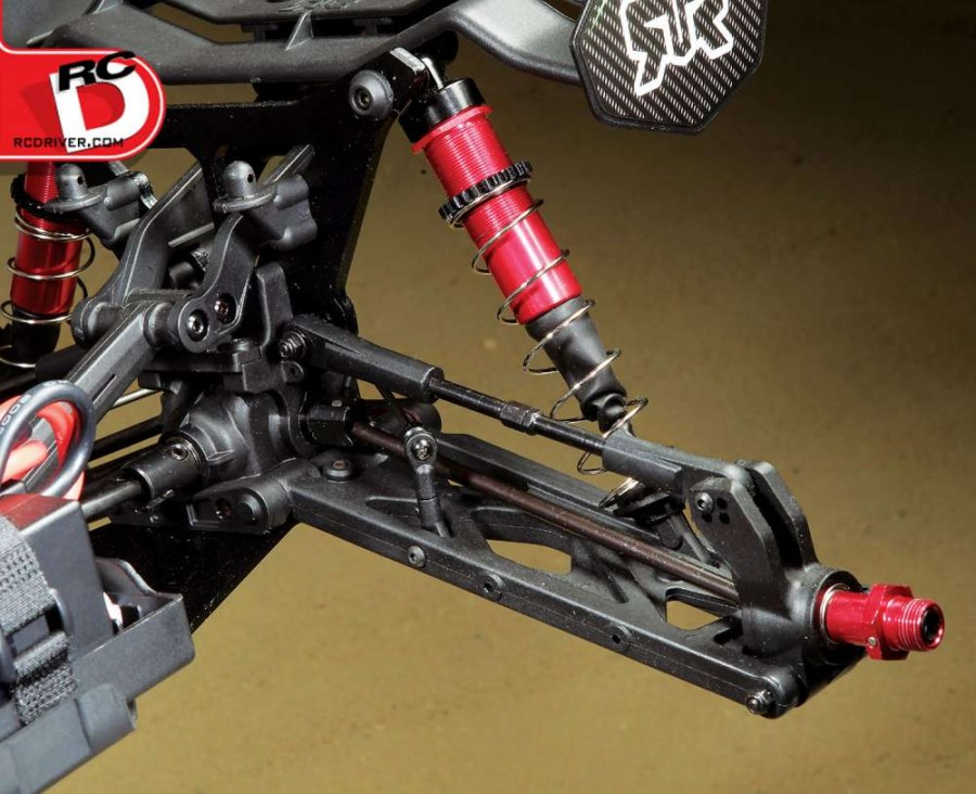 A rear set-up like this is boss, check out the thickness of the axles and upper camber links. The arms are rigid and that hub is massive and fitted with bearings to support the drive axles. Just add batteries and go, the Kraton comes fully assembled with electronics installed and the body painted. A few toolds and battery spacers are also includ- ed as is the pinion you see, it's for super insane speed runs.