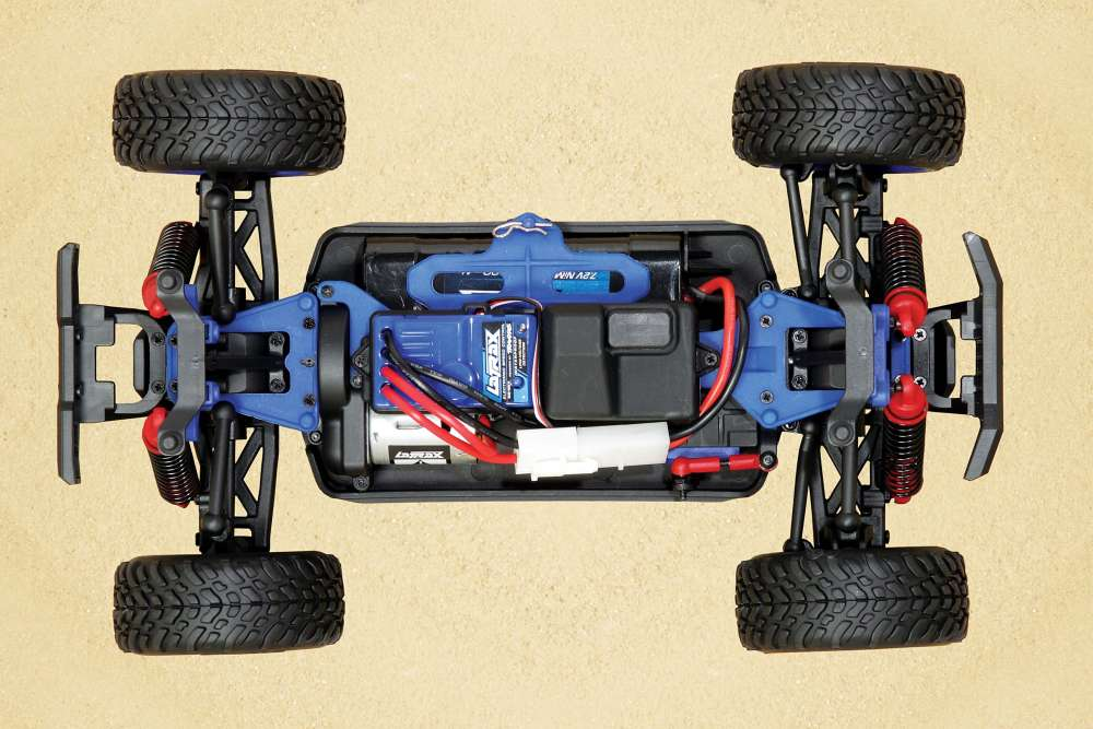 Such a neat and tidy little package when you look under the shell. Note the sealed receiver box and waterproof LaTrax speed control mounted down the center. The battery uses a standard Tamiya/JST connector instead of a TRX connector. I'd like to see the TRX used here for simplicity's sake.