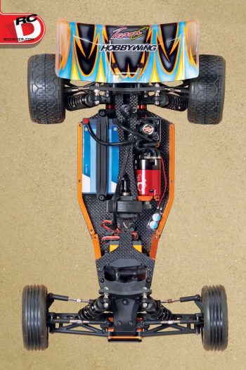 At first the TM2 V2 looks like a 4WD buggy ... until you notice the center mounted servo and lack of a front diff. The method behind this layout is to achieve perfect bal- ance with the bulk of the electronics weight placed directly over the CG point